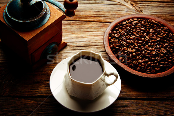 Coffee cup with vintage grinder on wood table Stock photo © lunamarina