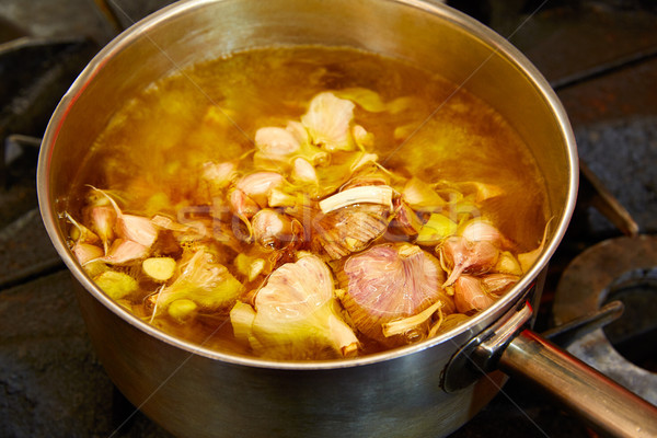 Garlic boiling soup in a pan Stock photo © lunamarina
