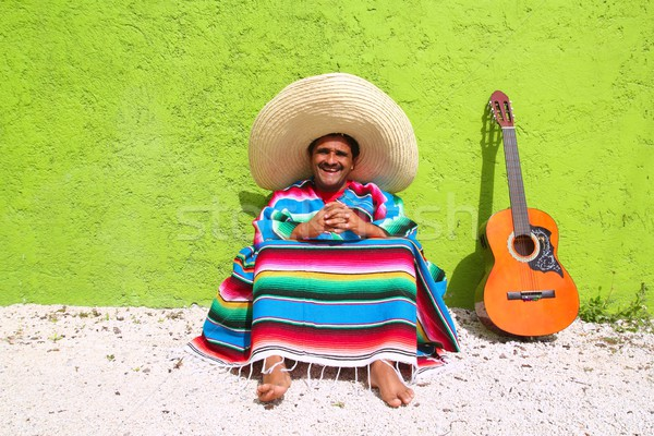 Mexican typical lazy topic man guitar poncho sit Stock photo © lunamarina