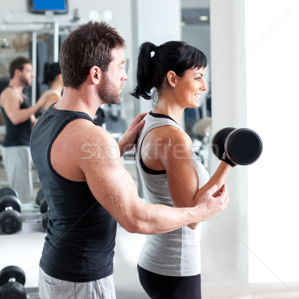 gym woman personal trainer with weight training Stock photo © lunamarina