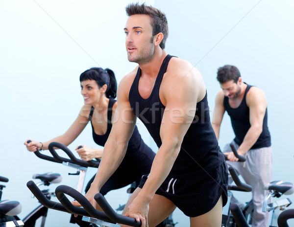 Stationary spinning bicycles fitness man in a gym sport club Stock photo © lunamarina