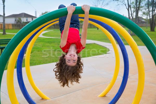 children kid girl upside down on a park ring Stock photo © lunamarina
