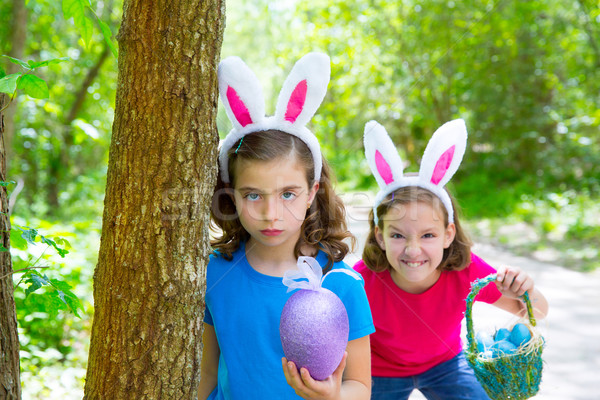Easter girls playing on forest with bunny teeth gesture Stock photo © lunamarina