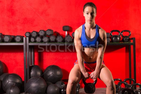 Kettlebells salıncak antreman eğitim kadın spor salonu Stok fotoğraf © lunamarina