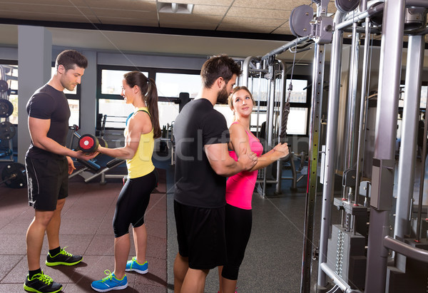 cable pulley system gym and dumbbell fitness people Stock photo © lunamarina