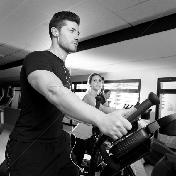 Aerobics elliptical walker trainer group at gym Stock photo © lunamarina