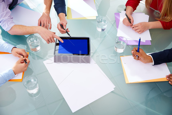 Business meeting aerial hands paper and pad Stock photo © lunamarina