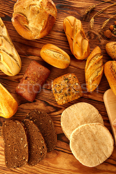 Bread varied mix on golden aged wood table Stock photo © lunamarina
