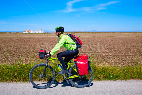 MTB Biker Bicycle touring with pannier racks Stock photo © lunamarina