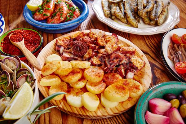 Tapas Spanyolország polip krumpli stílus piros paprika Stock fotó © lunamarina