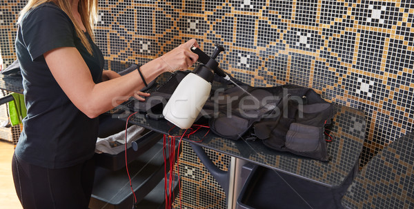Stock photo: EMS electro stimulation suit wet cleaning