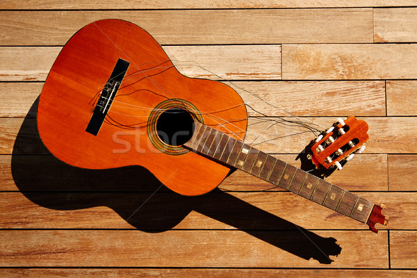 Stock photo: Broken spanish guitar neck on wooden deck