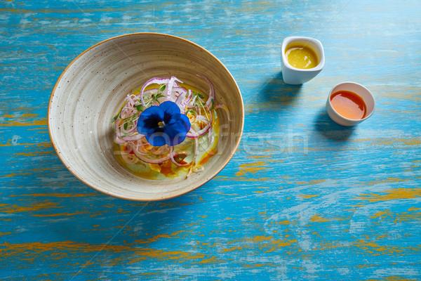 Fish ceviche preuvian recipe and pansy flower Stock photo © lunamarina