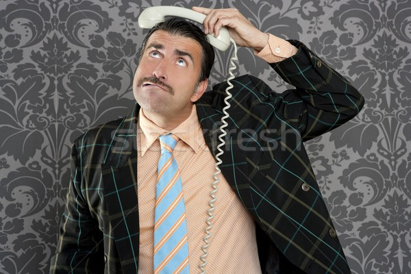 Nerd scared expression businessman telephone call Stock photo © lunamarina