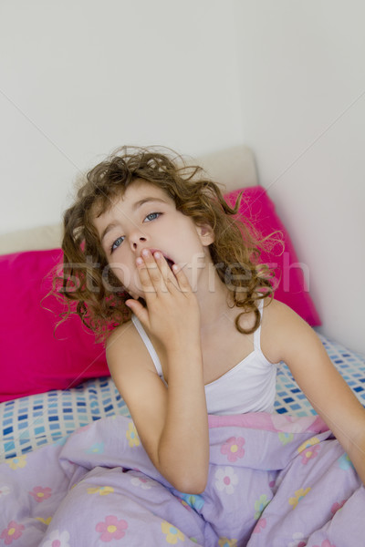 awakening girl yawning bed messy morning hair Stock photo © lunamarina