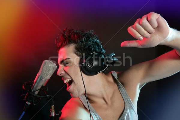 Dj with colorful light and music mixing equipment Stock photo © lunamarina
