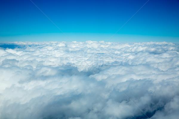 Fofo nuvens ver alto como Foto stock © lunamarina