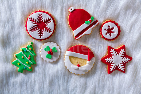 Christmas cookies Xmas tree Santa snowflake on white fur Stock photo © lunamarina