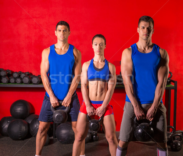 Kettlebell swing workout training group at gym Stock photo © lunamarina
