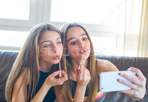 Teenager girls best friends makeup selfie camera Stock photo © lunamarina