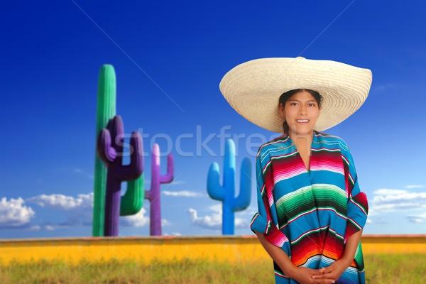 Mexican poncho serape girl big sombrero in cactus Stock photo © lunamarina