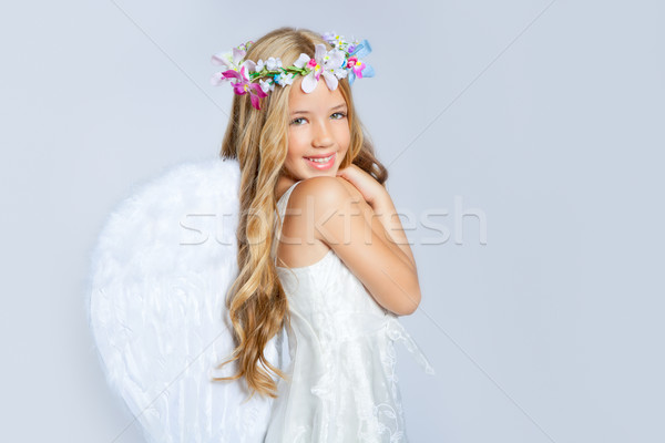 Stock photo: Angel girl children sweet expression and white wings