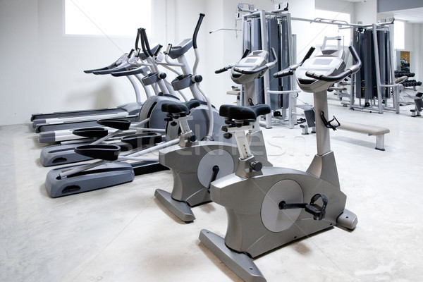 Stock photo: elliptical cross trainer, stationary bicycle treadmill
