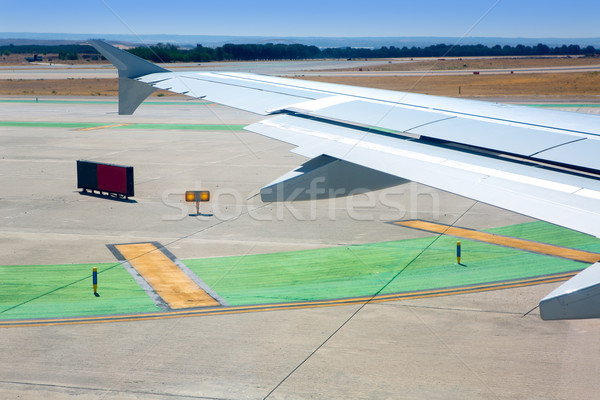 Airplane wing leaving the airport Stock photo © lunamarina