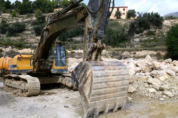Buldózer dolgozik kövek homok ipari hát Stock fotó © lunamarina