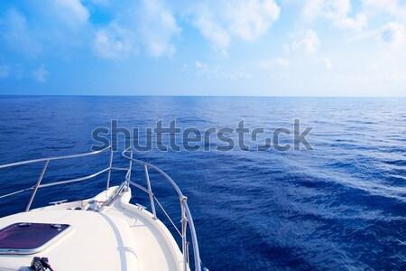 Boat rail with round orange lifesaver blue sea  Stock photo © lunamarina