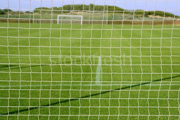Net soccer goal football green grass field Stock photo © lunamarina