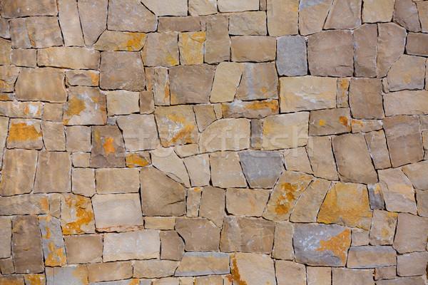 Alvenaria parede feito à mão pedras tradicional estilo Foto stock © lunamarina