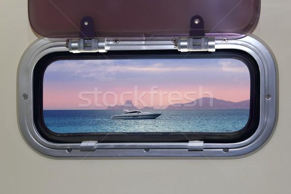 Boat porthole sunset view red blue ocean sea Stock photo © lunamarina