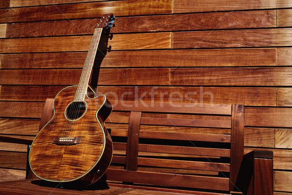 acoustic brown guitar in wooden stripes Stock photo © lunamarina