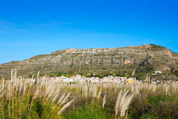 Cullera mountain with white sign writted on in Stock photo © lunamarina