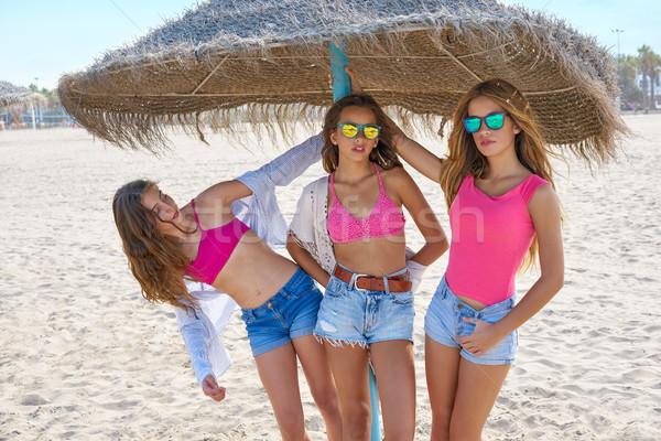 teen best friends girls under thatch umbrella Stock photo © lunamarina