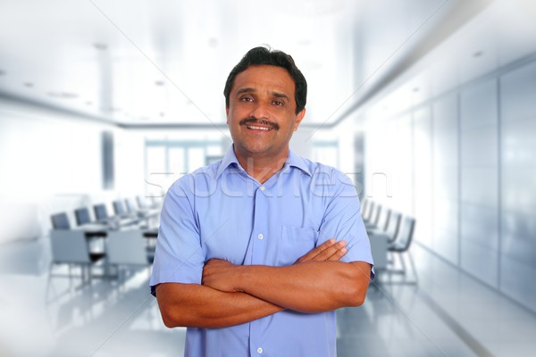 Indian latin businessman blue shirt in boardroom Stock photo © lunamarina