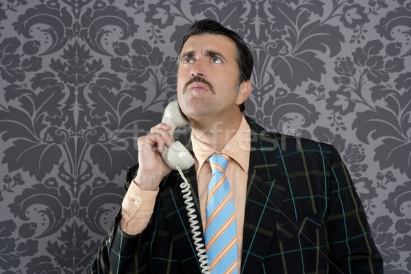 Stock photo: Nerd scared expression businessman telephone call