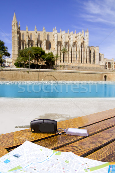 Car rental keys on the table with city tourist map in Palma Stock photo © lunamarina