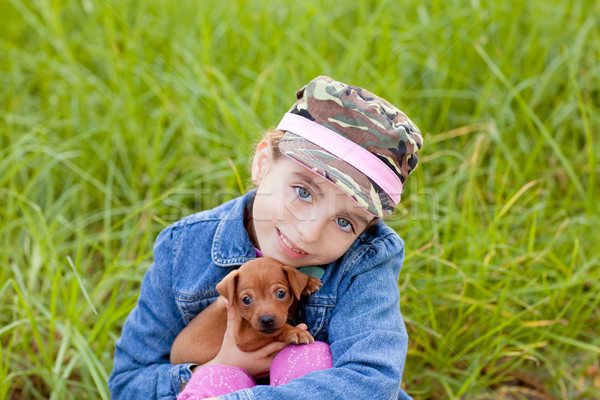 little girl with pet puppy mascot mini pinscher Stock photo © lunamarina