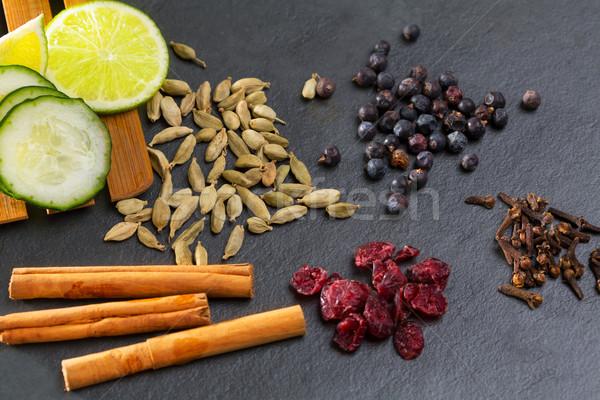 cloves cardamom cinnamon juniper berries and cranberries Stock photo © lunamarina