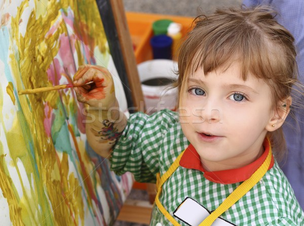 Stock photo: artist school little girl painting watercolors portrait