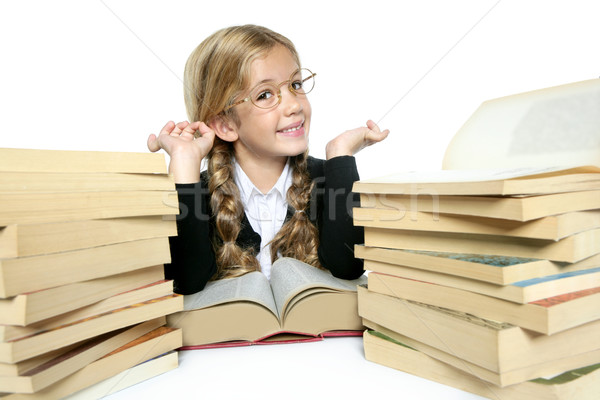 little student blond braided girl smiling with stacked books Stock photo © lunamarina