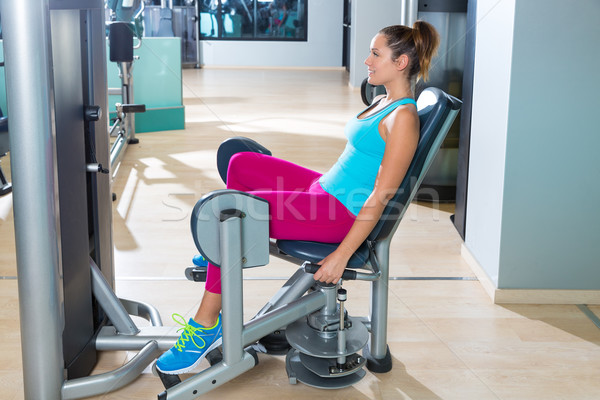 Hip abduction woman exercise at gym indoor Stock photo © lunamarina