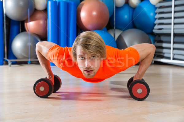 Blond man gym push-up pushup dumbbells Stock photo © lunamarina