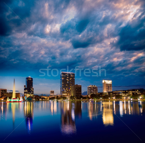 Orlando Skyline coucher du soleil lac Floride USA Photo stock © lunamarina