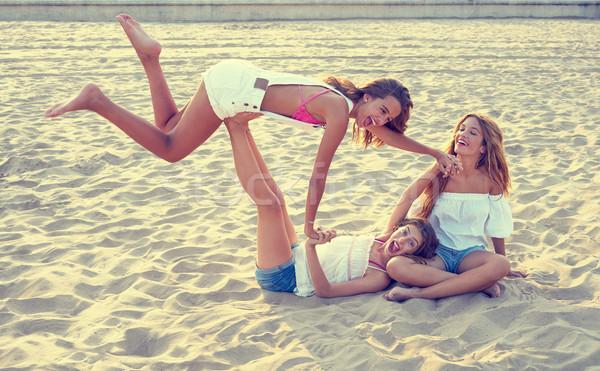 Best friends teen girls fun in a beach sunset Stock photo © lunamarina
