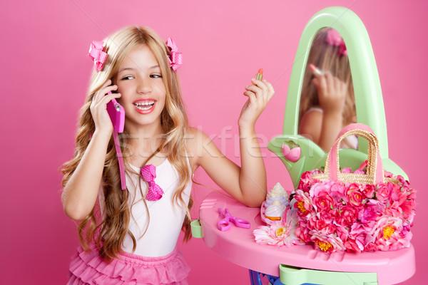 Children fashion doll blond girl talking mobile phone Stock photo © lunamarina