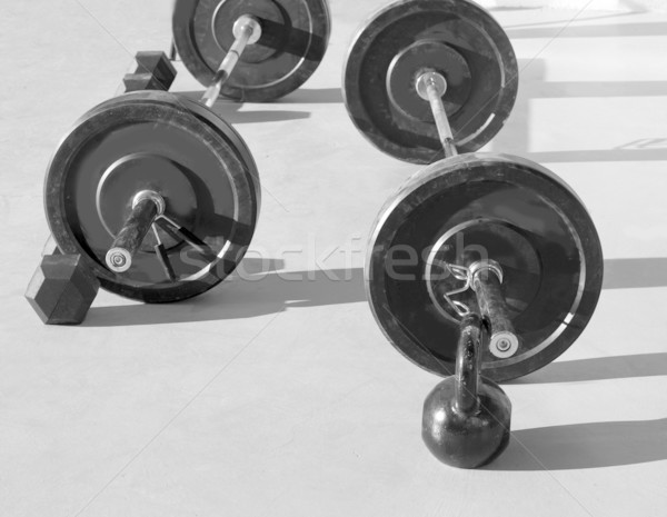 Kettlebells at crossfit gym with lifting bar weights Stock photo © lunamarina