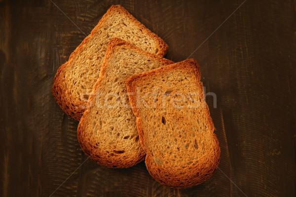Torrado pão fatias velho escuro madeira Foto stock © lunamarina